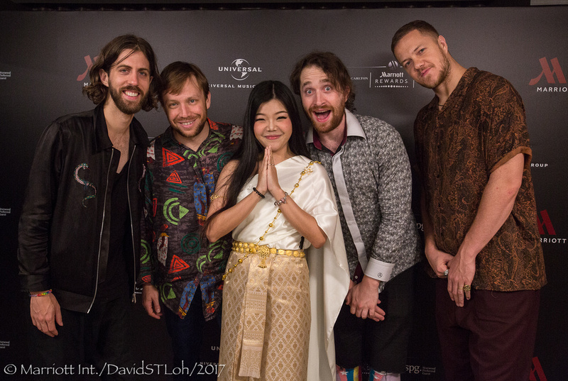 Imagine Dragons pose with a Thai staff at Bangkok Marriott Marquis Queen's Park
